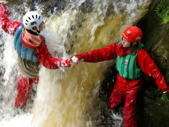 Explorer Scouts canyoning at their camp in Wales